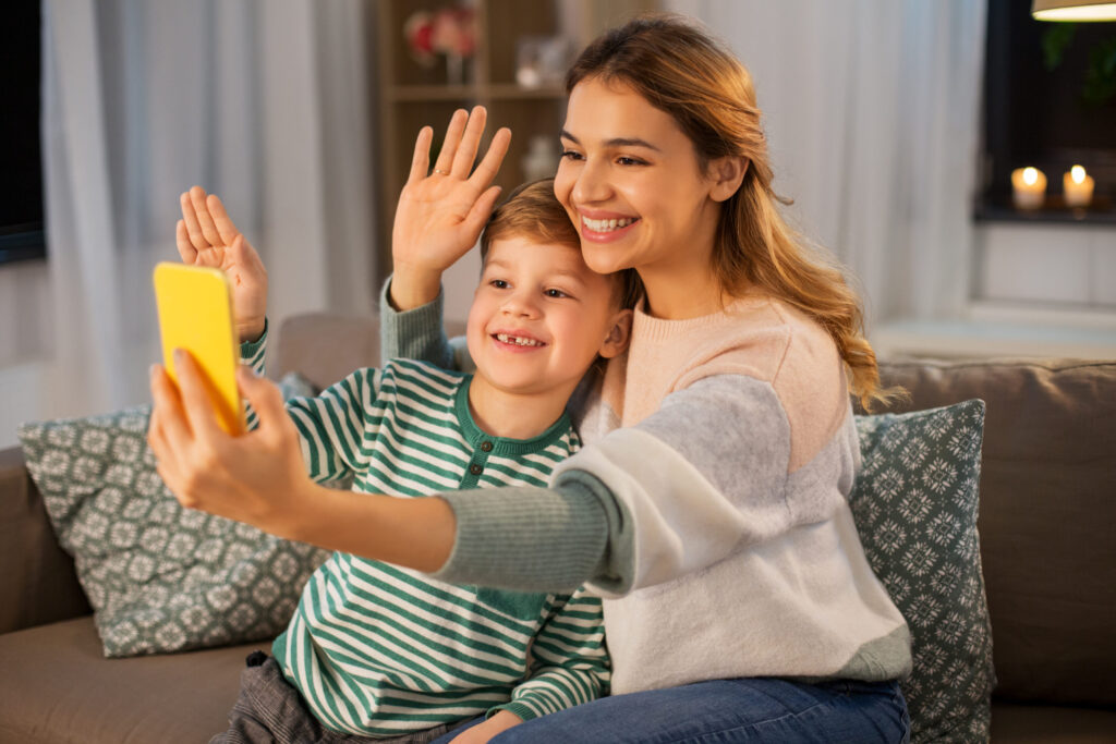 Mom and son staying connected to extended family and friends via video call.